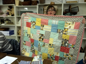 Our newest member Tarra! And the sweet cowboy quilt that she made for her son.