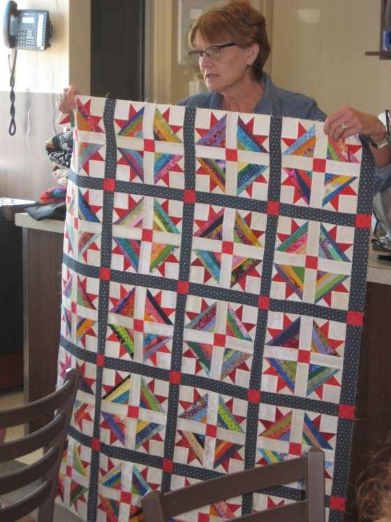 01-Val showing scrap paper piece quilt