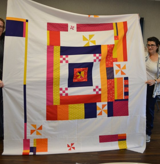 back of 2018 quiltcon charity quilt sherry